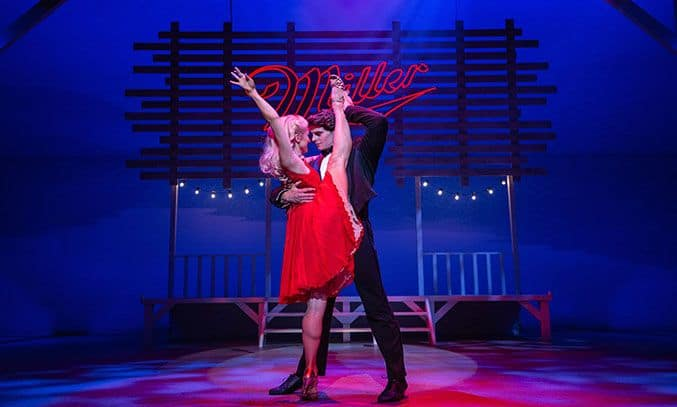 Michael O'Reilly (Johnny) and Carlie Milner (Penny) in DIRTY DANCING.